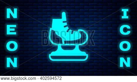 Glowing Neon Skates Icon Isolated On Brick Wall Background. Ice Skate Shoes Icon. Sport Boots With B