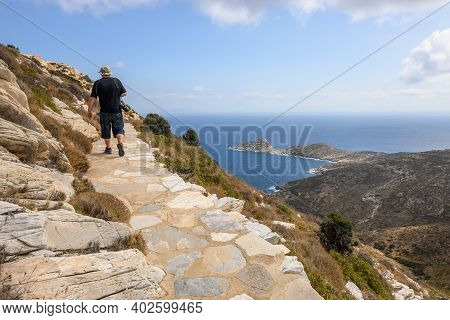 Ios, Greece - September 20, 2020: Winding And Paved Path Leading Up The Hillside To Reach Paleokastr