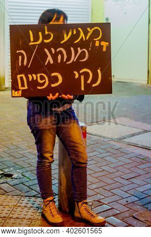 Haifa, Israel - January 09, 2021: Protestor With Sign Takes Part In The Black Flags Protest Against