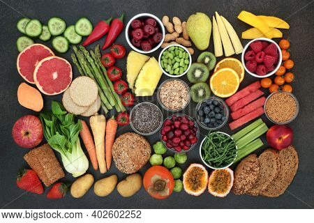 Vegan health food very high in dietary fibre and beneficial for a healthy digestive system. Foods also high in antioxidants, anthocyanins, vitamins, omega 3, protein and minerals. Top view on slate.