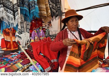 Pisac, Peru - September 04, 2016: Unidentified People Trade Colourful Goods In Marketplace In Pisac,