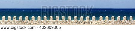 Stone Wall With Sea In Greece On The Island Of Crete.