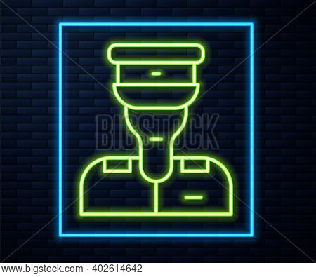 Glowing Neon Line Train Conductor Icon Isolated On Brick Wall Background. Vector