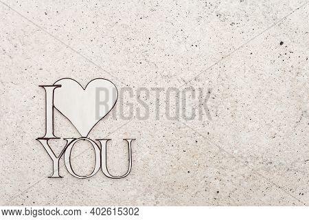 Valentine Day Background With Heart And Letters I Love You. Light Matte Beige Background, Flat Lay