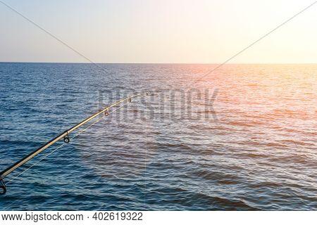 Fishing Rod. Fishing Tackle. Fishing Spinning Reel. Soft Lighting. Selective Focus Copyspace