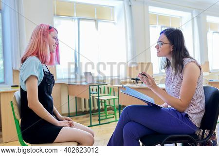 Woman School Psychologist Talking And Helping Student, Female Teenager. Mental Health Of Adolescents