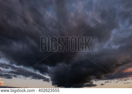Dark Ominous Gray Thundercloud. Dramatic Sky. Atmospheric Environment And Climate Weather Background