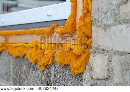 Construction Foam. Foam Of A Stroiteln At A Window. Dry Foam At A Window