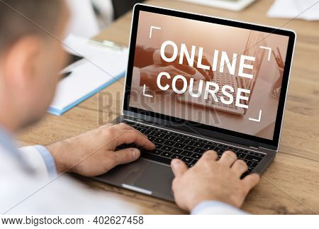 Unrecognizable Caucasian Businessman Or Manager Having Online Course On Laptop, Office Interior, Ove
