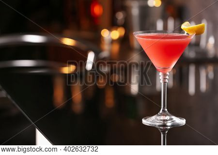 Cosmopolitan Cocktail On Black Table In Bar. Space For Text
