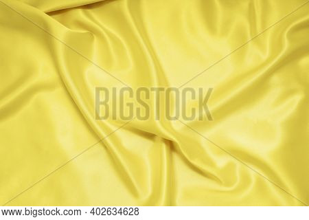 Yellow Texture Of Silk, Satin. Shiny Fabric Background.