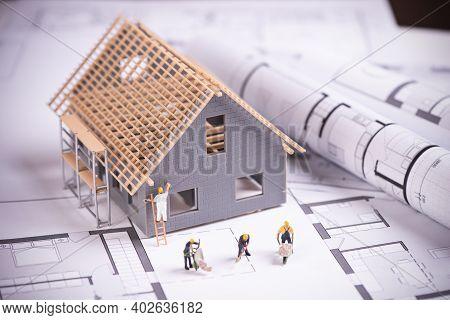 House Under Construction On Blueprints