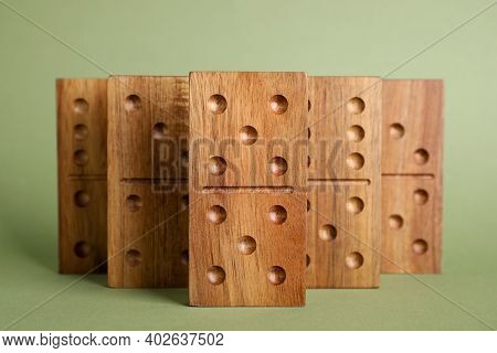 Wooden Domino Tiles With Pips On Green Background