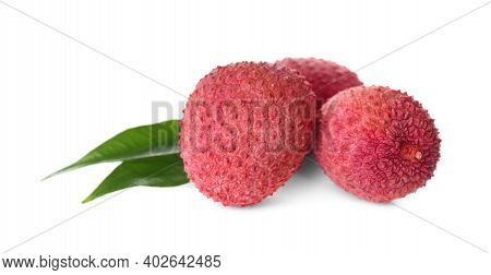 Fresh Ripe Lychees With Green Leaves On White Background