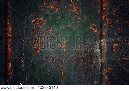 Rusty Metal Sheet With Cracked Paint. Texture Of Rust. Natural Rusty Background.