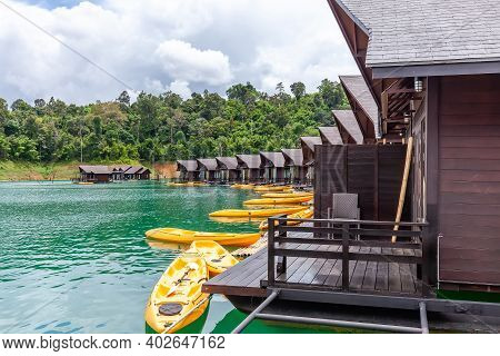 Luxury Resort With Floating Raft Houses With Kayaks On Green Lake With Tropical Trees. Traditional T