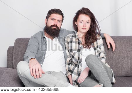 Regular Couple Relaxing On Couch. Session At Family Psychotherapist. Couple In Love Hug Looking At C