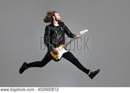 Rock Star. Rock Music. Jumping Man With Guitar. Electric Guitar. Man With Guitar.