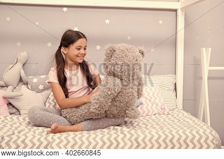 Play Games. Favorite Toy. Girl Child Hug Teddy Bear In Her Bedroom. Pleasant Time In Cozy Bedroom. G
