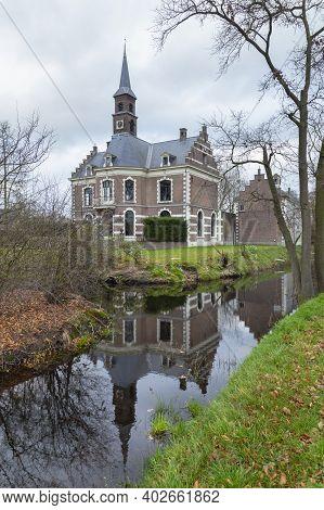 Ederveen, Netherlands - December, 12, 2020: Typical Dutch Castle De Bruinhorst At The Countryside In