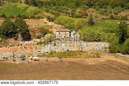 Saturnia, Italy - September 5th 2020. Tourists And Locals Bathe In The Hot Sulphur Thermal Waters At