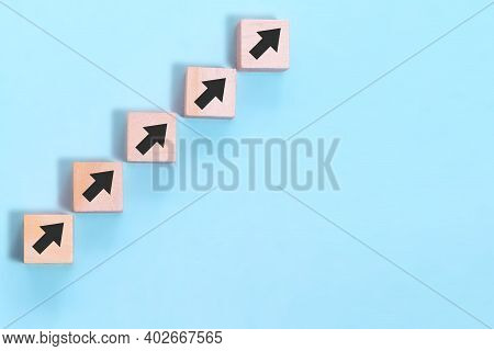 Business Concept Growth Success Process, Close Up Wood Block Stacking As Step Stair On Blue Backgrou