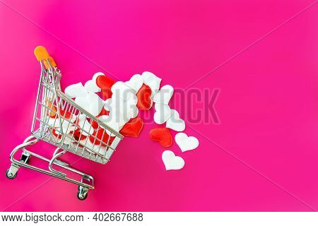 Shopping Trolley And Decorative Hearts On Pink Background With Copy Space. Valentine's Day, Mother's