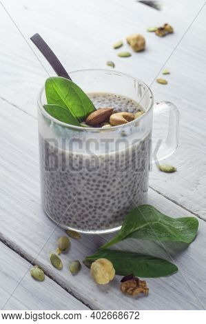 Chia Pudding With Spinach And Nuts In Almond Milk