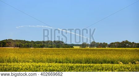 Landscape In The Agricultural Region Of The Heart Of France, Beauce, With An Irrigation System In Op