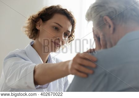 Compassionate Young General Practitioner Doctor Supporting Desperate Man.