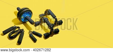 Flat Lay Of Sport And Fitness Equipment On Yellow Background With Copy Space. Illuminating Banner Of