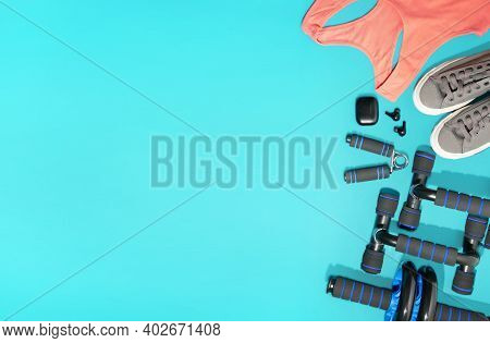 Flat Lay Of Sport And Fitness Equipment On Green Background With Copy Space. Pantone Banner For Stay