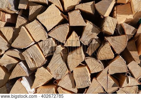 Background From Stack Of Firewood From Birch Tree, For Heating House, Stacked In Backyard, Uncut Woo