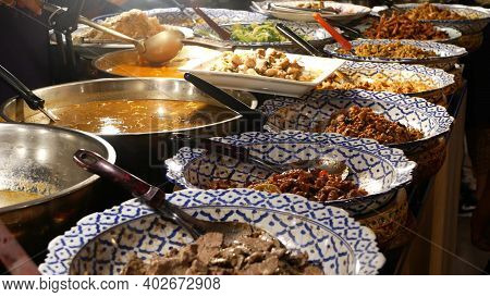 Bowls With Various Asian Dishes On Stall. Bowls Of Assorted Traditional Thai Dishes Placed On Stall