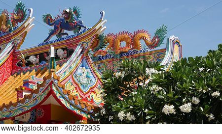 Traditional Oriental Taoist Chinese Monastery Temple Roof Details, Festive Dragon Decoration. Classi
