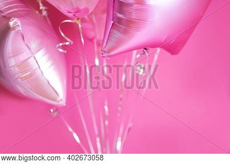 Pink Balloons With Helium On A Pink Background