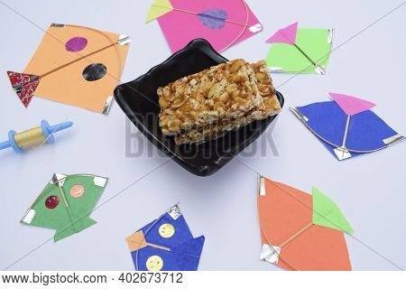 Peanut Chiki, Peanut Patti, Served In A Bowl, Many Types Of Kites Arranged Over Sing Chikki For Maka