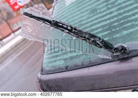 Icy Car Rear Window Wiper Close-up. Icy Car