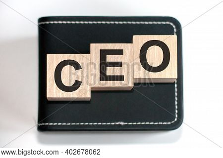 Motivational Words: Ceo In 3d Wooden Alphabet Letters On A Keyboard Background With Copy Space, Busi