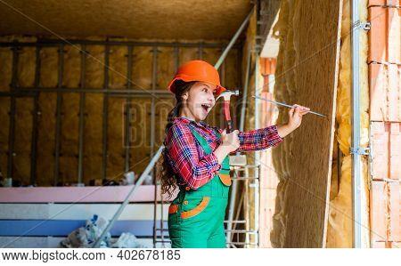 Teen Child Using Hammer Tool. Building And Repair Tools. Repairman. Girl Hammering A Nail. Small Gir
