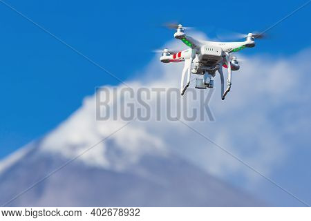 Uav Drone Quadcopter Flying In Sky, Aerial Shoot Videography Of Active Volcano Eruption, Mountain Pe