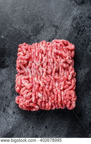 Raw Mince Beef, Ground Meat. Black Background. Top View