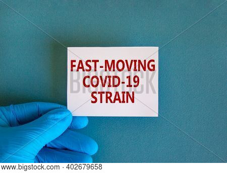 British Fast-moving Strain Covid-19 Symbol. Hand In Blue Glove With White Card. Concept Words 'fast-