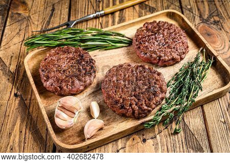 Barbecue Grilled Ground Beef Steak Patties, Mince Meat On A Wooden Tray. Wooden Background. Top View