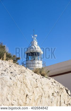 Tower Of Whitewashed Lighthouse Behind Rock Keeping A Smal Museum In The Natural Park Serra Gelada I