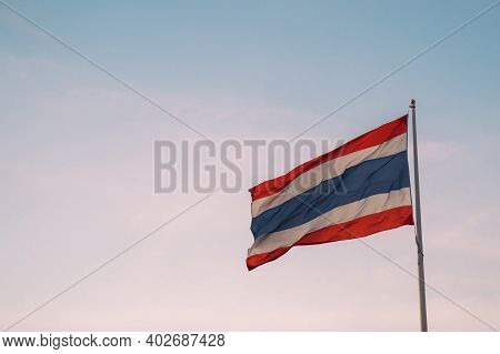 Thai Flag Fluttering With Wind Blow In Clear Sunset Sky Background With Negative Copy Space - Kingdo