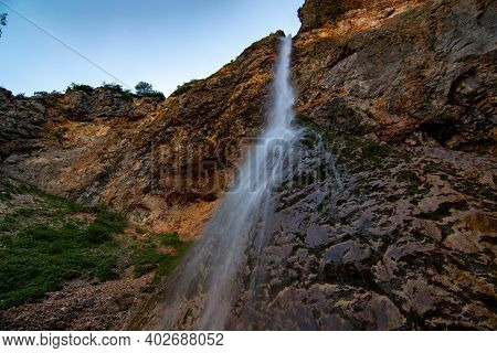 The Picturesque Waterfall Rinka Falls From A Steep Ledge. Slovenia, Logarska Dolina, Summer 2020