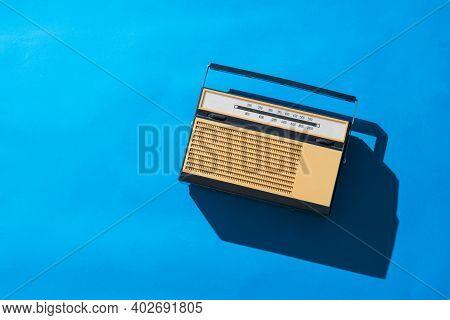 Retro Analog Signal Radio On A Bright Blue Background. Radio Broadcast Live. Vintage Technique.