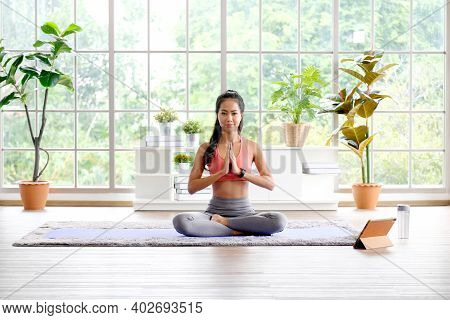 Asian Woman Practice Yoga Meditation Exercise At Home By Online Training Class, Young Asia Female Si