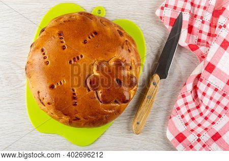 Homemade Savory Pie With Filling On Green Cutting Board, Kitchen Knife, Checkered Napkin On Wooden T